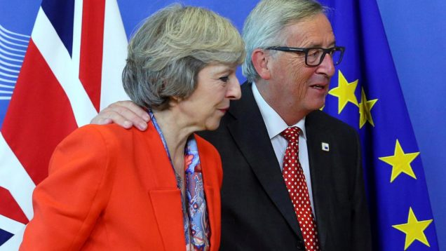 FILE PHOTO: British PM Theresa May is welcomed by European Commission President Jean-Claude Juncker at the EC headquarters in Brussels