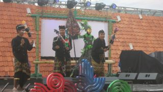 Puppeteers perform on stage with puppets made out of plastic waste in Jakarta